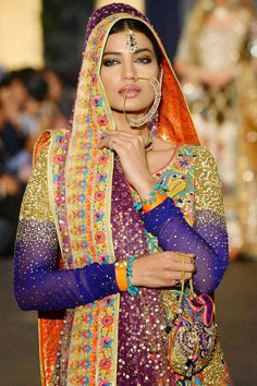 A model presents a creation by designer Nomi Ansari during the Pakistan Fashion Design Council (PFDC) Bridal Week in Lahore on October Pakistani Couture, Indian Couture, Pakistani Bridal, Pakistani Outfits, Indian Outfits, Emo Outfits, Ethnic Fashion, Asian Fashion, Punjabi Fashion