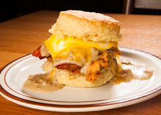 The Reggie Deluxe Sandwich - The Reggie Deluxe started as a combination of almost everything we were cooking at the farmers market. Fried chicken and biscuits being our specialty, we decided to see what a combination of our thick cut bacon on top of the chicken, smothered with gravy, and then capped with melted, oozy, gooey Tillamook Medium Cheddar Cheese, and topped off with a farm egg would be like. It was a ridiculous combination, and a unanimous success.