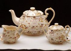Erika's Tea Room & Gifts | Teapots  Snowman Teapot 6 cup, 40oz Fine Bone China Gold Trimmed with Swirl Shape Matching creamer, sugar and cups and saucers available $28.99