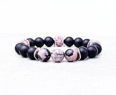 《《 OIL DIFFUSER COLLECTION 》》   ~~THE DETAILS~~  This handmade Aromatherapy Essential Oil Diffuser Bracelet is designed with Black  Pink Lava Stones, Black Vein Rhodonite  Matte Black Onyx Gemstones; finished with Silver Shiny Wavy Spacers!   ~~GEMSTONE BENEFITS~~  RHODONITE: Known as the Stone of Gemstone Bracelets, Bracelets For Men, Black Onyx, Matte Black, Aromatherapy Jewelry, Birthstone Charms, Oil Diffuser, Stone Beads, Lava