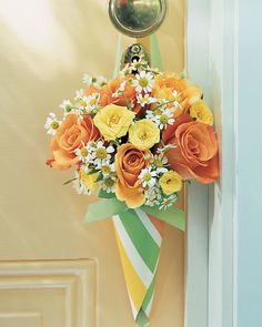 A popular May Day tradition of leaving a basket of treats or flowers on a neighbor's doorstep inspired this striped cone -- the handle makes it easy to hang posies from a friend's door.