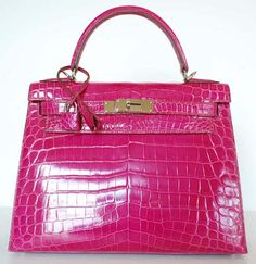 HERMES Fuchsia Pink Crocodile Kelly & Box This is an authentic pink Nile crocodile Kelly bag with palladium hardware The Nile cro Hermes Purse, Hermes Kelly Bag, Hermes Bags, Hermes Handbags, Fashion Handbags, Purses And Handbags, Fashion Bags, Birkin, Hang Loose