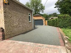 Resin Bound Driveways are mixed of natural aggregate, marble or recycled glass (stone) and clear resin. Book your free survey today or call 0800 1700 636 Driveway Apron, Resin Bound Driveways, Resin Driveway, Clear Resin, Recycled Glass, Hampshire, Sidewalk, Grass, Home