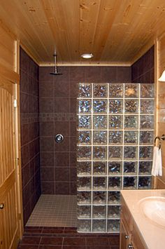 glass block shower wall with lodge cabin walls tile floor overhead shower