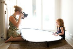 Automotive window shade can be used as a reflector for taking portraits! Super cheap solution.