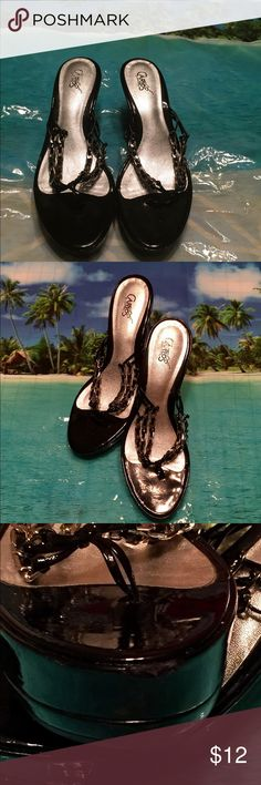 Carlos Santana Shoes Black patent leather toe wedge sandals. They make a pretty showing. Please see the picture showing the minor scuff mark. Carlos Santana Shoes Wedges