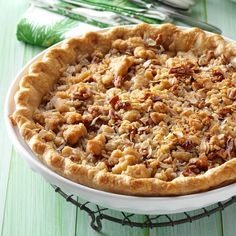 """All-Star Apple Pie Recipe -""""My two boys, Ben and Andy, made this scrumptious apple pie with a sweet, crunchy topping,"""" relates Cindy Glick of Bradford, New York. It's simple to assemble with a store-bought crust and canned pie filling, yet it tastes like it's made from scratch."""