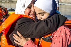 https://flic.kr/p/ypMhDZ | Syrian Refugees | Two Syrian women embrace after arriving on Kos in an inflatable dinghy on August 30, in Kos, Greece. Migrants from many parts of the Middle East and African nations continue to flood into Europe before heading from Athens, north to the Macedonian border. (Dan Kitwood/Getty Images)