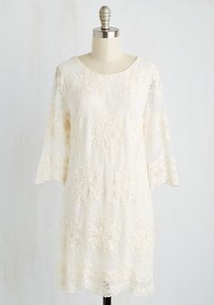 You know better than anyone how high love soars. But, your affection for this ivory dress? Unprecedented! Rapt by its embroidered flowers, deep V-back trimmed with crocheting, and bell sleeves, you make this lacy number look as irresistible as ever!