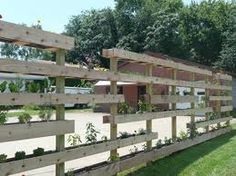 What a great fence doubling as a vertical garden