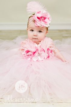 This full and graceful tutu dress is an elegant show piece that would dazzle even the hardest of hearts. The feather and rosette halter add extra flair to this daintly designed piece.  Shop Dollipops ♥