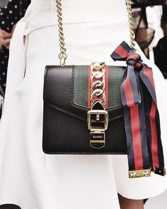679de96d176 A small accessory that will change your outfit completely. Wear all white  outfit with a Sylvie bag from Gucci for a party style.