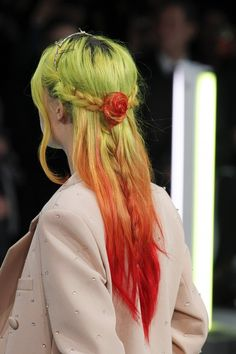 Green to orange ombre! Love how the orange ends make a cute rosette in this hair style!