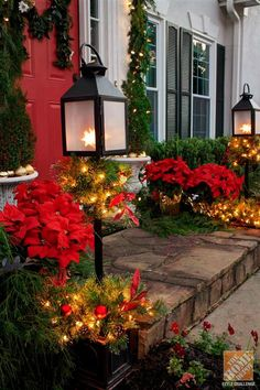 Even the smallest of front porches can still get decked out for the holidays! Try a couple of potted lanterns and silk poinsettias.