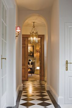 Entrance Hall - Belgium. Love black and white tile in entryway