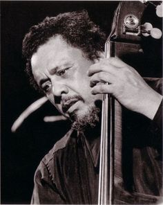 Charles Mingus addressing the audience at the Five Spot in NYC. (Photo Source)