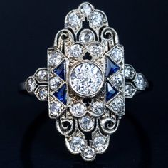 Art Deco Engagement Ring, Circa An ornate openwork white gold ring is centered with a bezel-set sparkling old European-cut diamond, flanked by triangular blue sapphires and old-cut diamonds. Bijoux Art Deco, Art Deco Jewelry, Jewelry Rings, Geek Jewelry, Crystal Jewelry, Diy Jewelry, Silver Jewelry, Or Antique, Antique Jewelry