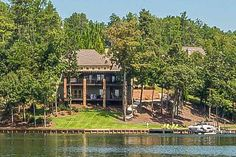 CLICK2TOUR this beautiful point lot home in Long Leaf on Lake Martin. 6BR/4.5BA, 2 living areas, 2 kitchens and 2 deep wrap around covered porches overlooking the lake. Spectacular views sunrise to sunset! For more details, call/text, Michael Langston-256-750-5200 or Windy Carter-256-749-1509 Lake Homes Realty. Photos & tour by Sherry Watkins…I Shoot Houses…http://www.Go2REassistant.com/VirtualTours.htm