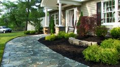 Front Yard Landscaping Ideas... I like the stamped pattern concrete... well the whole look is good.
