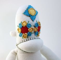 Callie Vera (get it?), the Day of the Dead sock monkey.  On Wumplekins' Etsy site for $35.00.