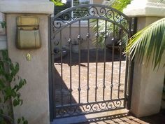 Wrought iron security gate for entrance to courtyard.