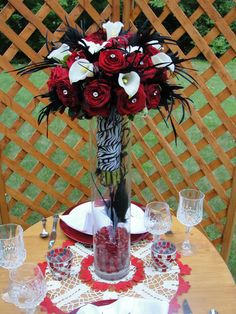 i love these centerpieces for a Red and Black Wedding... white to break it up and black feathers to liven things up and easy to diy