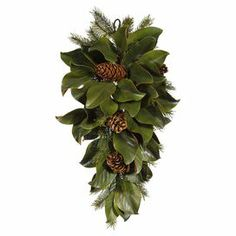 """Faux magnolia leaf and evergreen arrangement.  Product: Faux floral arrangementConstruction Material: Polyester and plasticColor: MultiFeatures:  Includes faux magnoliasGreat addition to any home or office Dimensions: 31"""" H x 14"""" W x 7"""" D Cleaning and Care: Dust with dry cloth"""