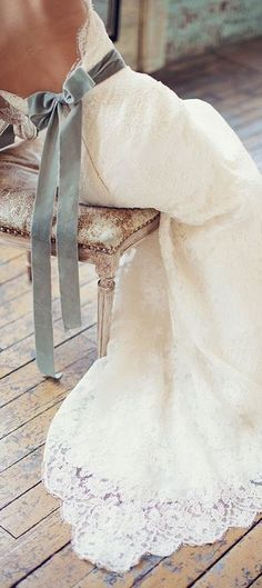 Velvet ribbon on her white wedding dress