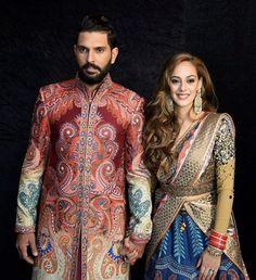 HD Photos of Yuvraj Singh-Hazel Keech Delhi reception.Yuvraj Singh and Hazel Keech at their wedding reception in Delhi.