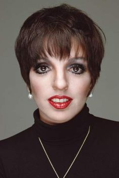 Liza Minnelli(; born March 12, 1946) is an American actress and singer. With a career spanning six decades, she has reached legendary status in multiple fields of entertainment and is among a small group of entertainers who have been honored with an Emmy, Grammy, Oscar, and Tony Award. She is considered both an American icon and a gay icon