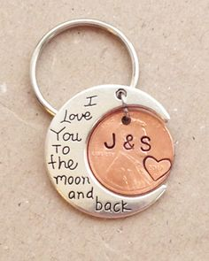 "This keychain would be the perfect gift to give your significant other for your wedding, anniversary, birthday, or just to show her you love her. The moon has ""I Love You to the moon and back"" stamped on it, and we customize the penny with any 2 initials of your choice, and stamp a heart around the year of your choice."