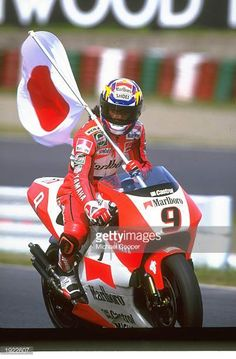 Norifumi Abe of Japan holds the Japanese National flag on his Yamaha after an emotional victory in front of his home fans during the Japanese Grand. Grand Prix, Ducati Monster 620, Valentino Rossi 46, Motorcycle Racers, Yamaha Motorcycles, National Flag, Road Racing, Motogp, Motorbikes
