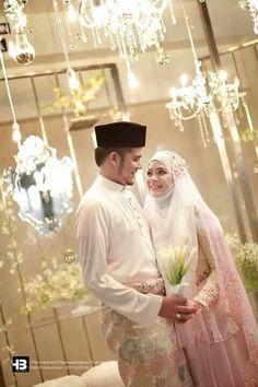 Simple Peplum touch & long veils. Very Modest. Malay Wedding