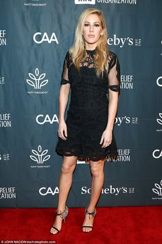 Sophisticated look: Ellie Goulding looked effortlessly stylish in an embellished black dre...