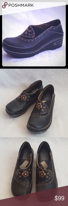 """NEW!!  L'Artiste Spring Step Leather Burbank Clog NWOT L'Artiste Spring Step black leather closed back clog with 2"""" heel and 3/4"""" platform. Embossed and hand painted wuth contrasting stitching. Lightly padded ankle collar and cushioned almost gel like insole. Style is """"BURBANK"""". Size 35.  Womens 5 or Girls 3 1/2.  New, without tags. Smoke free and pet free home.   Check out my other listings - 100's of 👠shoes👠, 👢boots👢 and 👜bags👜. Bundle 2 or more and save money!💲💰💲 Spring Step…"""