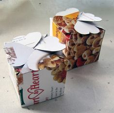 More ideas for what to do with empty cereal boxes: Fold them into smaller boxes and use for gift-giving or for storage of your own small things. This post links to three box-folding tutorials, including one that'll make hexagon-shaped boxes.