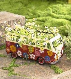 Inspired by vintage vans, our groovy Flower Power Bus Planter adds a pop of retro color on patio, porch or deck.  Fill our Metal Flower Power Bus Planter with a small potted plant for a whimsical display indoors or out. Bright colors, fun and funky design. Handmade of recycled metal by artisans in Bali.