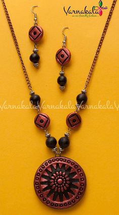 METALLIC RUST & BLACK   Embossed Terracotta jewelry  by Varnakala