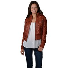 Flaunt trend-setting style in this hooded jacket by Hailey Jeans Co! Fully lined in faux fur, this jacket features colored faux leather exterior in a fitted design.  Textured buttons and top-stitching create flattering detail that on this fall essential.
