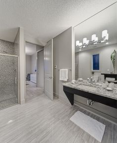 Ensuite Bathroom - Wheelchair accessible bathroom with heated tile floors, granite countertops, and roll-in shower