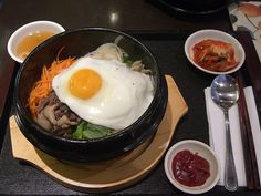 A Korean breakfast – breakfast is similar to lunch and dinner in Korea. You'll get a small plate of kimchi, a bowl of rice and a bowl of clear vegetable soup.  A good old-fashioned slice of toast is also a popular choice, but that doesn't make for nearly as good a picture.