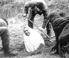 This woman is being buried in preparation to stone her to death.  Her terror and agony are unspeakable.