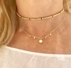 Belinda Gold and Red Beaded Adjustable Choker with Iris Opal Drop Pearl Necklace on Gold Chain https://www.bettinascollection.com/products/belinda-gold-and-red-beaded-choker