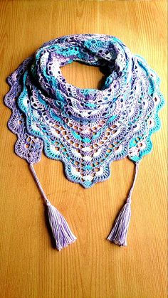 This bright multicolor crochet shawl attracts attention. Blue crochet scarf feels very soft, light and comfortable to wear. Cotton crochet scarf good for summer evenings, spring, autumn. Triangle scarf combines perfectly with jeans, blue, turquoise, lilac, pink, white color clothes.