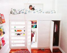 A playhouse and closet under the bed platform