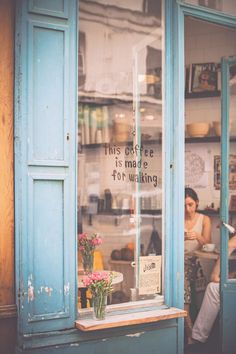 "LIKE: ""THIS COFFEE IS MADE FOR WAKING""   can we put this in our window,  like the architecture, the flowers the window sill.   Don't know how that helps with branding....  Coffee"