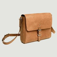 "Stylish, stitched ethical leather satchel made from fair-trade, veg-tanned eco-leather. Suitable for most 13"" laptops."