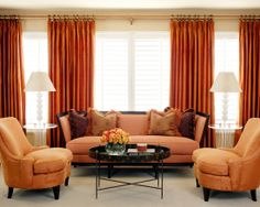 this monochromatic orange living room sets an energetic mood burnt orange living room furniture