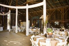 Drapes to cover the poles in front barn area with a center swag of fabric to cover the center dance floor area?