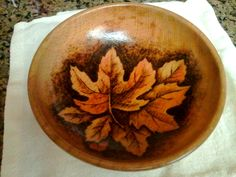 Fall leaves burned onto a wooden bowl, colored with oil pencil. Gift to my wife.